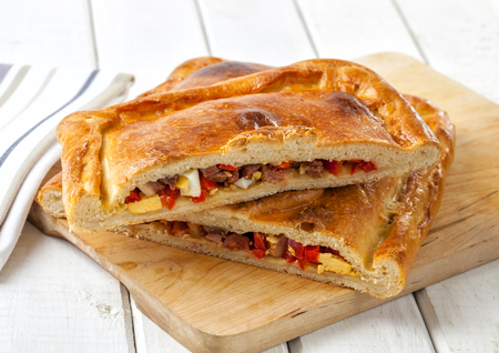 An empanada is a stuffed bread or pastry baked or fried in many countries of Latin America and in Spain.