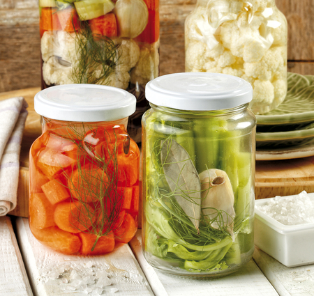 Preparing homemade preserves and pickles on a wooden table Stock Photo