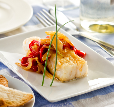 Bacalao or cod served with bell pepper onion and garlic.
