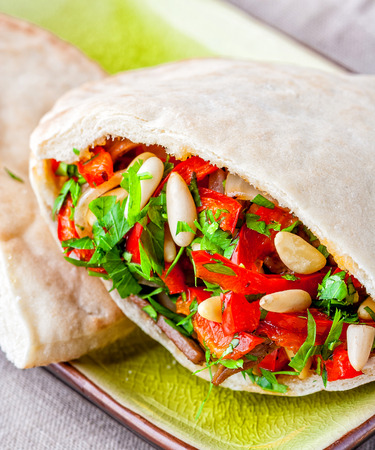 Delicious doner kebab sandwich with vegetables and pine seeds Stock Photo