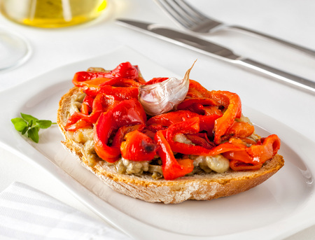 Escalivada on toast. Escalivada is a traditional Catalan dish of grilled eggplant and bell peppers with olive oil.