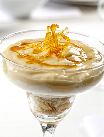 Custard dessert with spun sugar decorations made with sugar syrup or caramel.