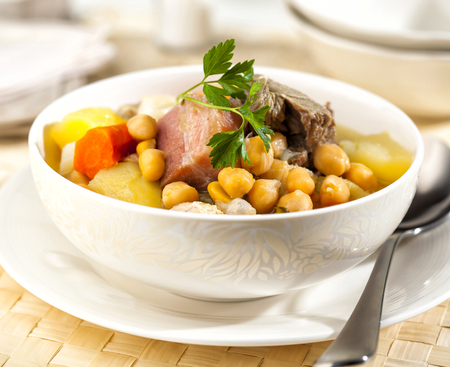 Cocido is a traditional Spanish stew prepared with chickpeas, meat and sausages.