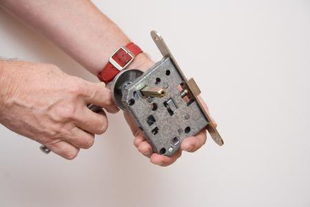 Handyman repairing a door handle