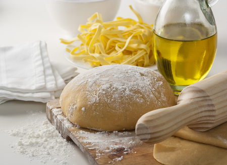 Making homemade pasta dough with flour and olive oil.