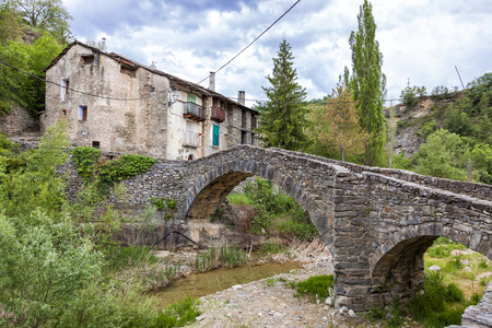 Old village of Montanana, Huesca Province, Aragon in Spain. Bridge over the river.