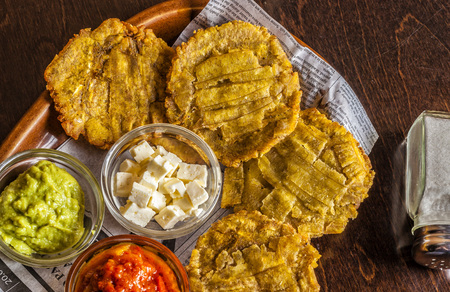 Patacones or tostones are fried green plantain slices, made with green plantains. Typical food from Mexico and South America.