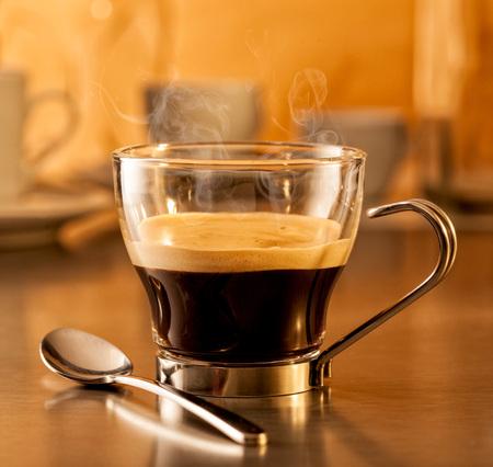 Hot steaming espresso coffee in a glass cup 版權商用圖片