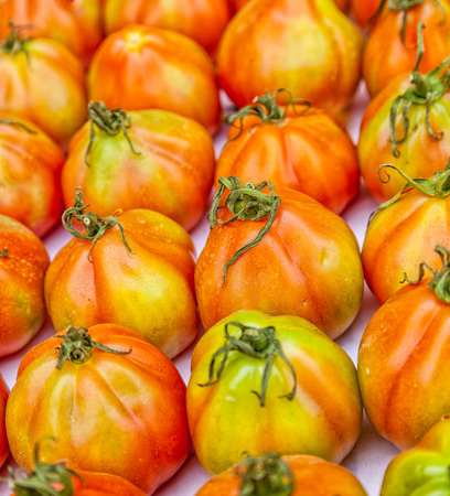 Oxheart tomato from Liguria called Cuore di Bue at a market stall.