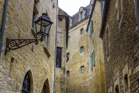 SARLAT-LA-CANEDA, FRANCE - MARCH 2, 2011: Detailed view of the medieval buildings in the old centre of the town of Sarlat-la-Caneda, Perigord, France.