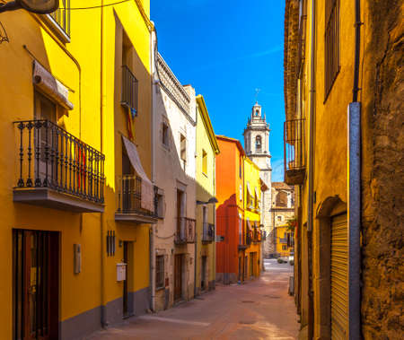 Village scene with colorful houses and church of Celra, Emporda, Ampurdan, Spain