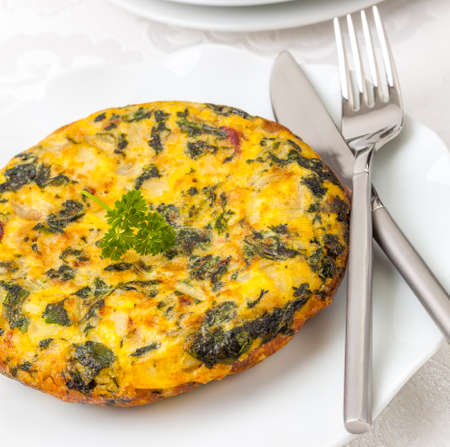 Thick omelet Spanish style with potatoes and spinach