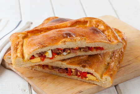 Spanish meat pie filled with chorizo, egg and bell pepper.