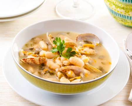 Seafood chowder served with beans