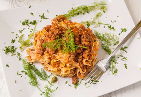 Italian food: tagliatelle bolognese. Pasta with ground meat. Stock Photo