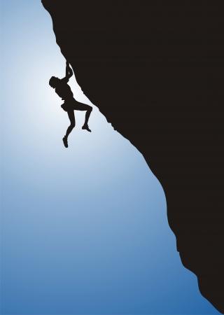 Man when free climbing as silhouette
