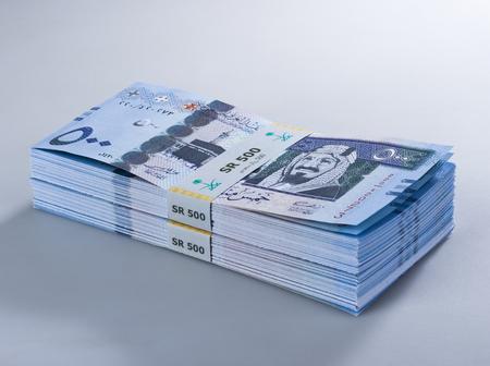 Pile of Saudi Riyal Banknotes of 500 with image of King Abdulaziz Closeup