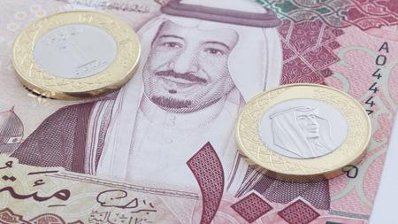 Saudi Riyal 100 Banknote and New Coin showing King Salman of Saudi Arabia