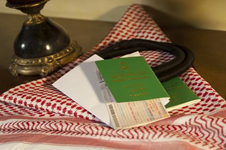 Saudi Travller Document Passport Flight Ticket Saudi Riyals Money and American Dollars Still Life with Shumagh Head Cover