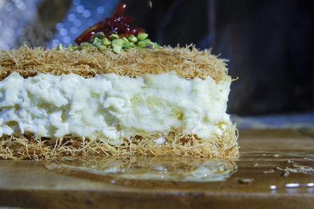 Pouring Syrup on Osmaliya, Arabic Sweets with Cream for Ramadan and Eid