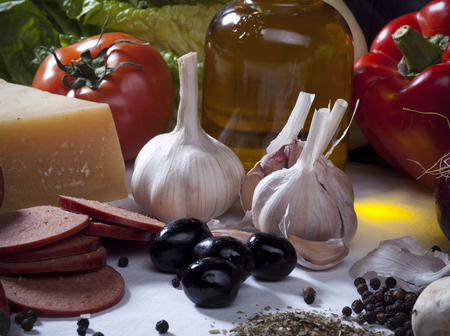Vegetables Still Life Composition with Meat, Cheese, Eggs, Spices, Olive Oil, and Other Food Ingredients