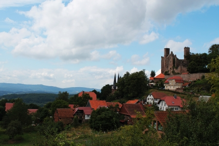resides: A castle ruin that resides over a small village in Germany  Now a popular visit for tourists, it once served as a lookout due to its proximity to the East-West German border  Editorial