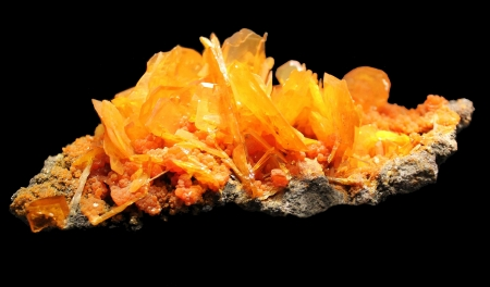 covalent: Wulfenite, a beautiful yellow crystal with the chemical formula of PbMoO4