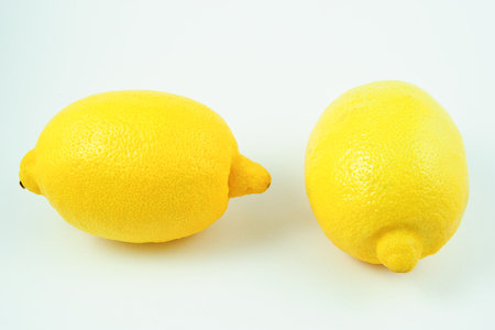 citric: closeup view of lemons on white background