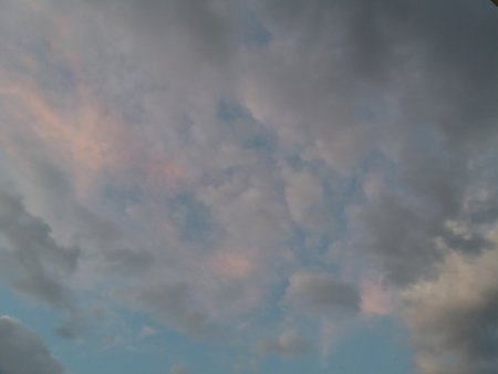White, pink and gray clouds in a blue evening sky Stok Fotoğraf