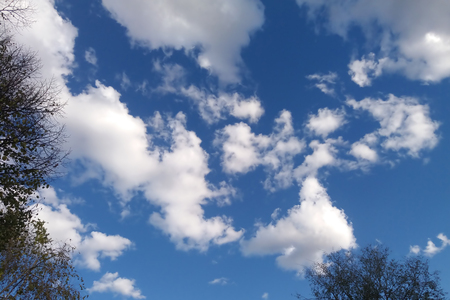 Autumnal clouds and blue sky on a sunny day