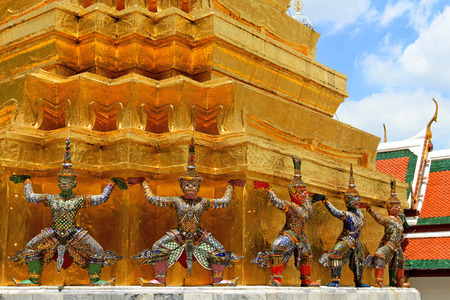 The Ramayana giant statues are standing at Wat Ph-ra Kaew Ancient temple in Bangkok, Thailand Stock Photo