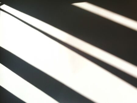 Line of black shadow on white background. Shade of sunlight