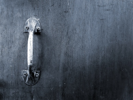 Close up stainless steel handle of door or window on the wooden background in black and white style with copy space - Art and Abstract wallpaper concept Banque d'images