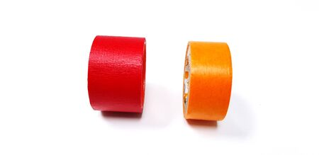 Red and orange tape isolated on white background Фото со стока