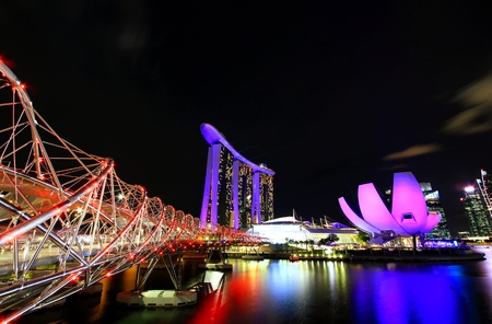Singapore, Singapore - May 25, 2018: Colorful cityscape light of Marina Bay Sand building and Helix Bridge or Double Helix Bridge at night in Singapore - The famous place for all tourism travel