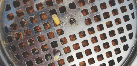 Top view of Cigarette stub in stainless steel or aluminum ashtray - Smoking area, Unhealthy and Not good for health concept Imagens