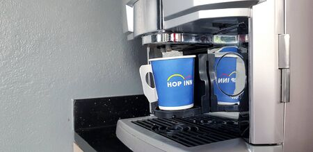 Songkla, Thailand - January 21, 2019 : Blue cup of coffee with coffee maker machine and copy space - Technology device, Refreshment drinking in the morning and Drinking concept
