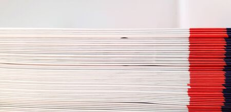 Close up pattern and line of white, red and blue spine or saddle book are sorting and stacking for background with above space - Art group of object, Education and Library concept Archivio Fotografico