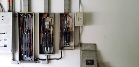 Many circuit breaker for distribute electricity in building on white wall with right copy space in main electrical room Banco de Imagens