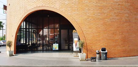 Ayutthaya, Thailand - January 26, 2018: Exterior design of Starbucks coffee cafe shop in brown brick building style. Starbucks Corporation is an American global coffee company and coffeehouse Редакционное