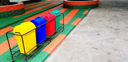 Colorful of four recycle bin or garbage for dumping waste on footpath with copy space - Cleaning city, Green world, Nature, Reduce material concept