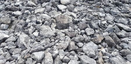 Group of gray stone or rock on ground for background or wallpaper - Hard material add Heavy object