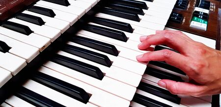 Close up hand playing piano or press elect tone keyboard. Object, Musician  and Instrument concept