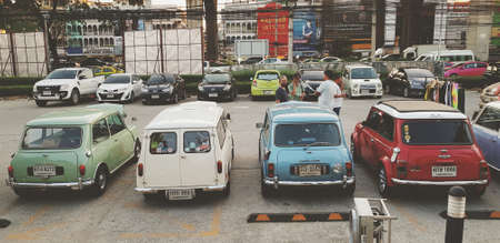 Bangkok, Thailand - June 20, 2020: Classic mini cooper parked on street with in vintage tone. Vintage car and Retro style