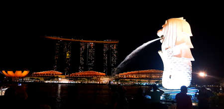 Many people travel to visited Merlion park to see twilight at night with marina bay building background. Landmark in Singapore and Famous Asia place