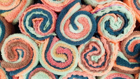 Top view of colorful towel or hand towels for background. Textured pattern of cotton or fabric wall. Art color wallpaper and Shape of object.