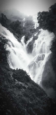 ฺBeautiful heart shaped waterfall or Pe To Lo Su Waterfall at Tak province, Thailand in black and white tone. Landmark for hiker travel to see  beauty natural in deep jungle or tropical forest.