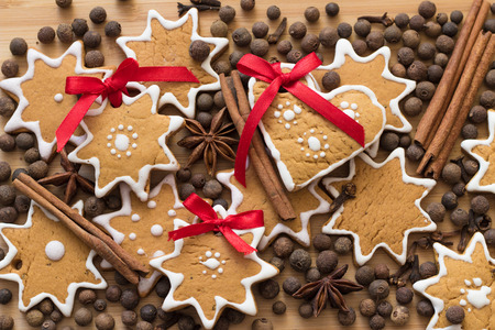 Gingerbread and spice scattered on a wooden table photo