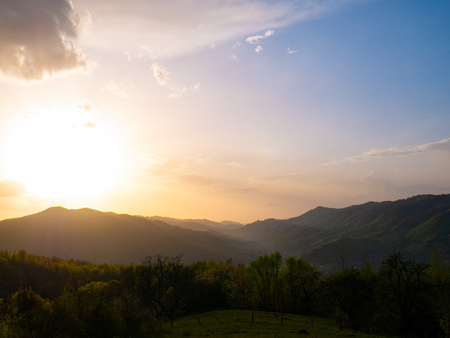 Beautiful landscape in the mountains at sunset. View of colorful sky with clouds.