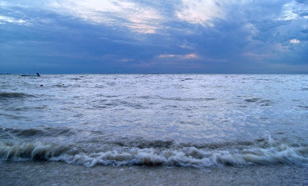 View on sea and clouds before storm in twilight